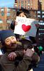 Father & Son - Help Japan (Rachel Citron) Tags: nyc newyorkcity red manhattan photojournalism documentary gothamist fatherandson littleboy curbed reportage nikond40x thelocaleastvillage helpjapan manhattanusersguide rallyunionsquare newyorkersforjapan