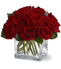 "#08ED $65.95 Simply Elegant Roses. This compact design of one dozen roses in a square vase makes a lasting impression.  Roses cut short will last longer than the traditional long stem arrangement.  Add more roses for a larger impact. • <a style=""font-size:0.8em;"" href=""http://www.flickr.com/photos/39372067@N08/5551528935/"" target=""_blank"">View on Flickr</a>"