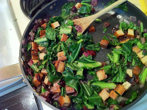 kale with dried cranberries and pieces of baked tofu