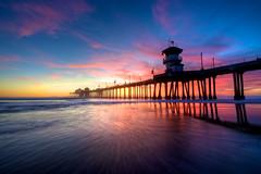 Rushing Wave (cloudbi) Tags: ocean california ca sunset sea clouds coast pier twilight sand wave lowtide huntingtonbeach costal huntingtonbeachpier huntingtonpier nikkor1424mm