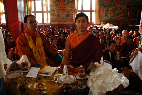 Tibetan-American princes – Sakya Dungses: HE Zaya Vajra Sakya and his son Lama HE Avikritar Rinpoche, silk table cover, katags, tea cups, censor, offering rice, Dharma books, Lamdre, Tharlam Monastery of Tibetan Buddhism, Boudha, Kathmandu, Nepal
