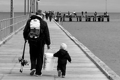 Helping Dad (robktkate) Tags: ocean street wood city travel sea vacation people blackandwhite fish water monochrome photography pier photo bucket fishing holding hands nikon dad child photos candid father small australia son wharf learning teaching rods bait helping bonding frankston portphilipbay frankstonpier nikon1855mm d5000 nikond5000