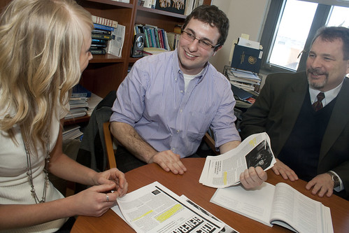 Jake Tenenbaum '11 (center) meets with Caitlyn Reinecker '11 and Professor Mark Cordano. Photos by Lauren DeCicca.