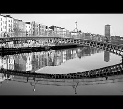 Ha'penny Bridge (Mick h 51) Tags: bridge ireland bw dublin reflection canon river liberty eos hall iron pedestrian liffey explore cast 1855 hapennybridge libertyhall siptu 1816 explored haypenny 450d