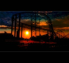 Blackpool II (Chariots_of_Artists) Tags: uk sunset red england sky orange silhouette clouds dark illuminations tram amusementpark rollercoaster blackpool touristattraction pleasurebeach searesort thedigitographer mygearandme mygearandmepremium mygearandmebronze mygearandmesilver mygearandmegold speddingsart chariotsofartistsleveli
