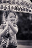 Rain rain go away... (BJRainbow) Tags: girls portrait blackandwhite bw white black girl rain kids umbrella children kid child play 15 tint winner blacknwhite tone sweep bnw challenges rockon flickrchallengegroup flickrchallengewinner 15challengeswinner challengegamewinner thechallengefactory yourockunanimous herowinner cutecuterortoocute
