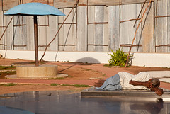 ind-1041 (Ed Peters 286) Tags: sleeping india umbrella streetscene tamilnadu pondicherry