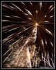 Demise of Apophis (Cygnus~X1 - Visions by Sorenson) Tags: christmas november winter sky orange usa white yellow bronze canon eos gold glow unitedstates bright fireworks action idaho explore glowing radiant 2010 pyrotechnics pocatello ef24105mmf4lisusm aerialdisplay christmasinthenighttimeskies 5dmkii craigsorenson bannockcountyfairgrounds 20110225083115mdt