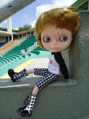 picture of doll sitting in empty stadium