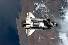 The ISS casts a shadow on Discovery (astro_paolo) Tags: nasa discovery esa 133 internationalspacestation spaceshutle europeanspaceagency expedition26 sts133 magisstra