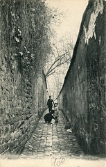Rue Berton, Paris (c.1905) (pellethepoet) Tags: boy people man paris france men bicycle kid europe child postcard cobblestone photograph lane stonewall enfant gamin garçon postman shoelaces passy cartepostale rueberton cartespostalesanciennes