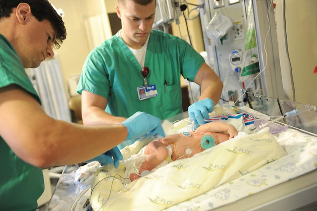 Neurosurgeons checking on his back