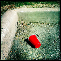 Red Cup (sunraa) Tags: red cup trash parkinglot assignment squareformat bsquare 477 project365 dailyshoot johnslens hipstamatic blankonoir