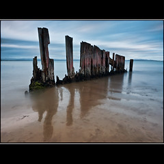 (David Panevin) Tags: longexposure morning sky bw seascape motion beach water clouds landscape object australia olympus lauderdale tasmania e3 beforesunrise sigma1020mmf456exdchsm southarm bwnd davidpanevin