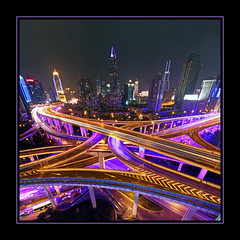 All roads lead to Shanghai (b80399) Tags: china city blue light skyscraper highway asia crossing purple shanghai traffic autobahn trail busy intersection jam congestion