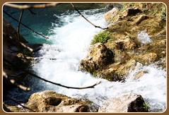 Foaming bubbles.!!!! (Mumsie Wood) Tags: blue plants brown white green water spain beige rocks view branches bank foam flowing twigs splashing algarwaterfalls