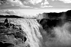 Dettifoss (spag photography) Tags: travel white black nature water clouds river landscape waterfall iceland nationalpark rocks europe alone spag vatnajkull northeasticeland vatnajkullnationalpark spagphotography blackandwhitebwdettifosspeople