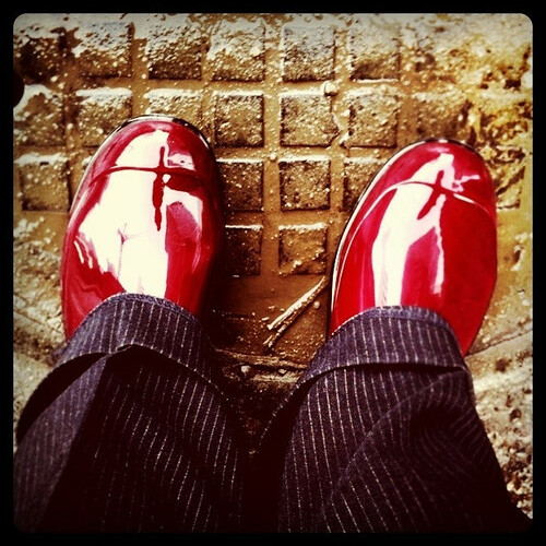 my new red rubber boots take to the streets