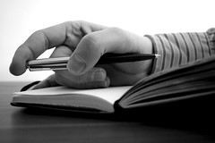 Pensive (grahamashton) Tags: moleskine pen notebook