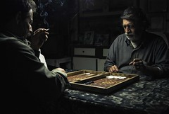 The game III (georgekamelakis) Tags: lighting light people man game men greek nikon hand cigarette smoke atmosphere ring greece backgammon tavli d80 georgekamelakis