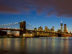 Twilight in New York City (jp3g) Tags: city nyc moon newyork buildings twilight brooklynbridge eastriver bluehour freedomtower