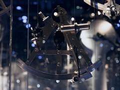 Sextant on display (Long Sleeper) Tags: museum thenationalmaritimemuseum display instrument sextant glass light bokeh amsterdam holland thenetherlands lumixg425mmf17asph dmcgx1