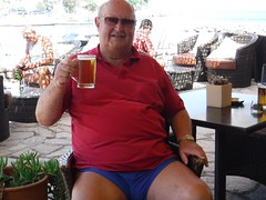 A Lunchtime Alph beer (pj's memories) Tags: corfu mensshorts shorts speedos commando alphabeer