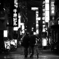 (Dylan-K) Tags: street city people white man black love girl leather bike japan walking photography nikon couple alone candid bikes jacket osaka namba nikkor 85mmf14 dylank
