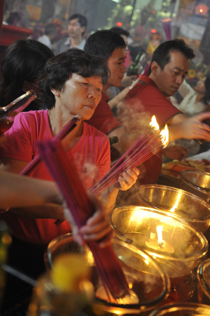 Lighting incense at a Chinese temple in Indonesia. (Photo credit should read Romeo Gacad/AFP/Getty Images)