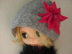 Pink flower on grey hat