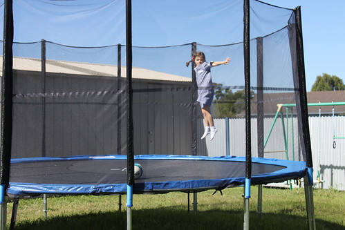 Esther up on trampoline