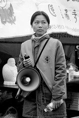 SF Chinatown: Candid Girl (shaire productions) Tags: sf sanfrancisco california blackandwhite bw woman girl monochrome lady female asian photo waiting asia chinatown image candid chinese young monotone photograph grayscale greyscale