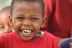 African boy with huge grinning smile. Massive teeth! (Aris Vrakas) Tags: boy black smile kids kid funny dancing african teeth grin grinning grimace township portelizabeth ubuntueducationfund boysmileteeth