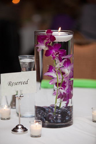 diy submerged orchid centerpiece with floating candle wedding green
