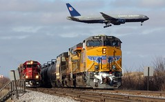 Triple Seven and Double Delight (Laurence's Pictures) Tags: road county railroad chicago cars up electric train airplane airport track pacific general aircraft united union transport engine cook rail canadian aeroplane line ohare motors transportation transit milwaukee planes locomotive boeing airlines soo ord 777 ual freight emd franklinparkillinoisrailroads