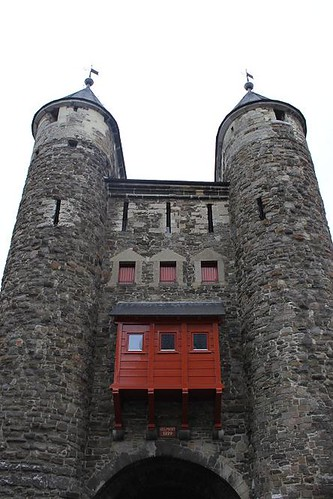 front view of city gate with red windows