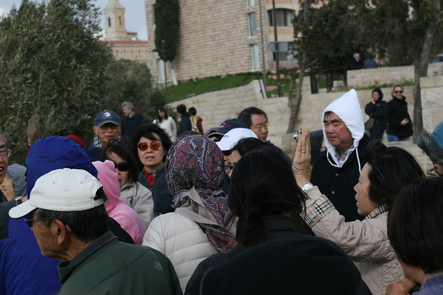 Asian Christians sing hymns on the Mount of Olives