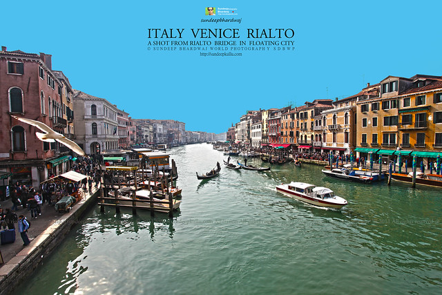ITALY VENICE A SHOT FROM RIALTO BRIDGE WITH GONDOLA PEOPLE AROUND RESTAURANTS VAPOURISER TAXIS 1261 AWFJ by Sundeep Bhardwaj Kullu Himachal 50 Countries 200