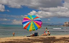 Under the Rainbow (jcc55883) Tags: ocean beach hawaii nikon waikiki oahu pacificocean waikikibeach beachumbrella nikond40 kapiolanibeachpark