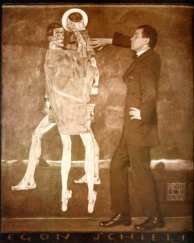 Egon Schiele before his painting Begegnung (Encounter), 1914