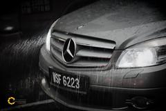 Wet Mercedes (Tareq Abuhajjaj   Photography & Design) Tags: light sky bw white black cars car rain sport speed dark photography lights benz design photo high nice nikon flickr power wheels dream gear arabia manual carbon rims  2010 tareq     tareqdesigncom tareqmoon tareqdesign  abuhajjaj