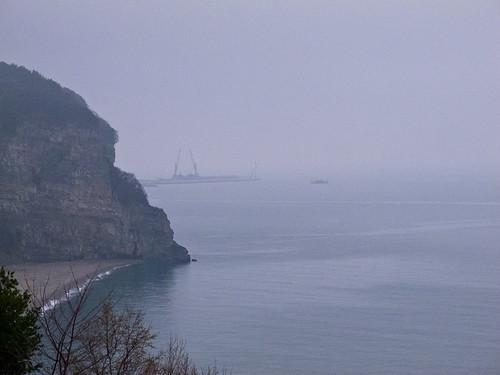 Misty coast + factories