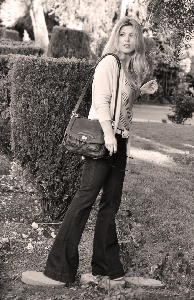 flared jeans shoulder bag blonde hair black and white