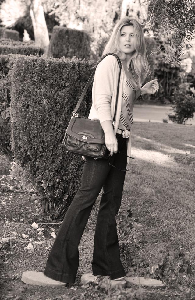 flared jeans shoulder bag blonde hair black and white