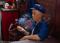 Old Man Smoking Bamboo Pipe, Qingyan (adventurocity) Tags: china travel vacation man tourism stone photography town photo asia photographer pipe picture oldman visit tourist smoking traveller adventure prc smoker guizhou visitor traveler peoplesrepublicofchina pipesmoker bamboopipe pipesmoke qingyan