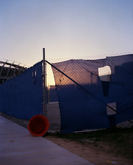 (Brian Luman) Tags: light sunset ohio film fence gold evening football construction kodak cincinnati brian medium format portra 513 160nc paulbrownstadium mamiyarz67 luman bluefence statum brianluman
