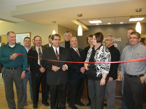 Bill Menner, USDA Rural Development State Director in Iowa, (center) participates in a ribbon cutting ceremony for a new health clinic in Woodbine, Iowa.