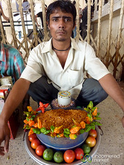 Selling Chanachur at the Srimongal Station - Bangladesh (uncorneredmarket) Tags: people food man vendor snacks streetfood bangladesh dpn srimongal chanachur namkeens