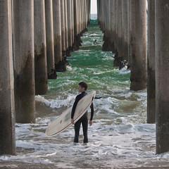 the decision (DMotown) Tags: ocean california ca pier surf waves pacific surfer pacificocean 365 pillars day109 huningtonbeach april2011 3652011 2011365 pinn060712