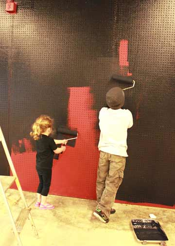 Skyler and Alex helping paint